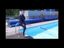 Wetlook beautiful girl fully clothed in pool