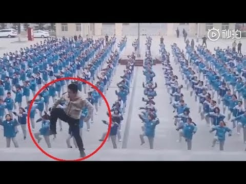 Chinese school teacher becomes internet star after leading 400 pupils in viral salsa dance routine