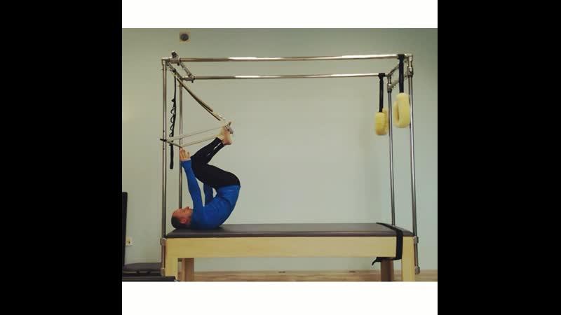 Monkey spine massage. Pilates trapeze-table.