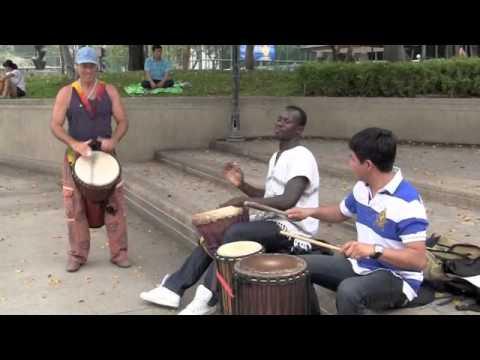 African Djembe Rhythms for beginners nice slow Sinte in Bangkok Park,w Michael Ousman and Luis