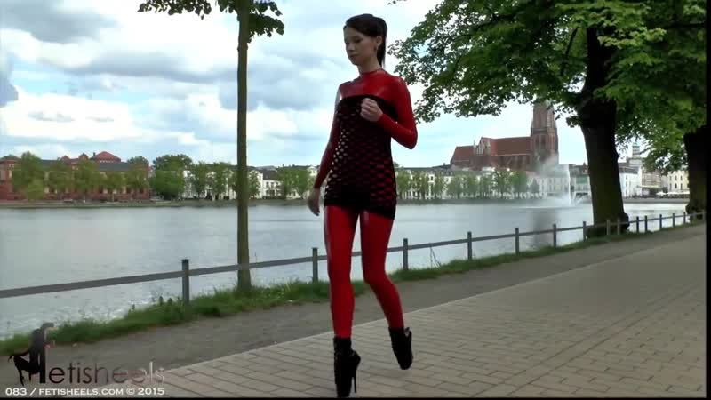 Red Latex Girl in Extreme High Heels