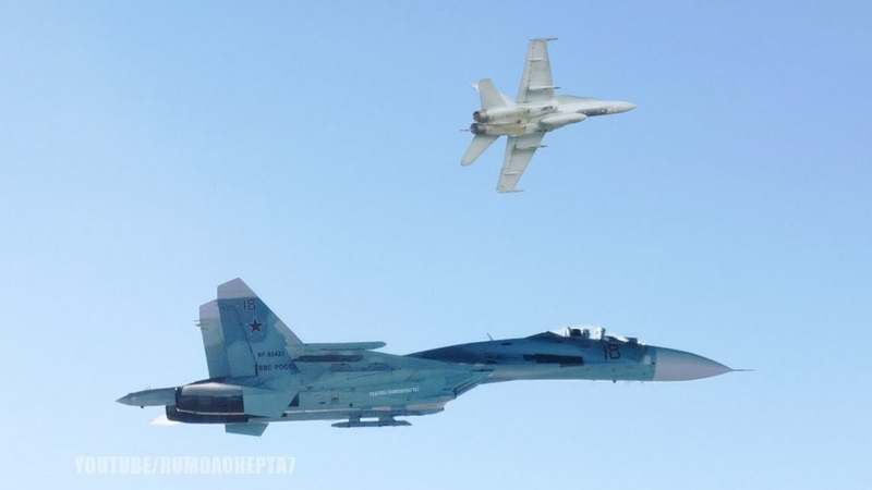 Russian Sukhoi Su-27 Jet Pushes NATO's F-18 away from Shoigu's Plane