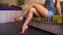 Feet model in nylon pantyhose shows her legs and soles