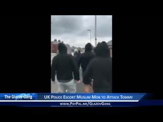 Glazov moment  uk police escort muslim mob to attack tommy. robinson.