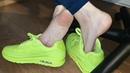 Sweaty bare feet straight from neon sneakers