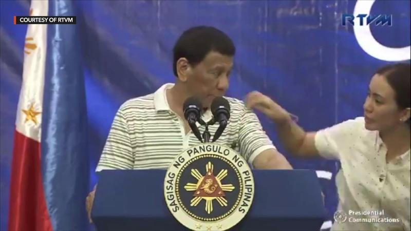 Cockroach lands on Duterte's shoulder