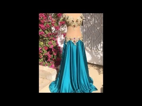 Blue skirt with golden bra and belt. Belly dance costume by Sufel Boutique. ベリーダンス衣装