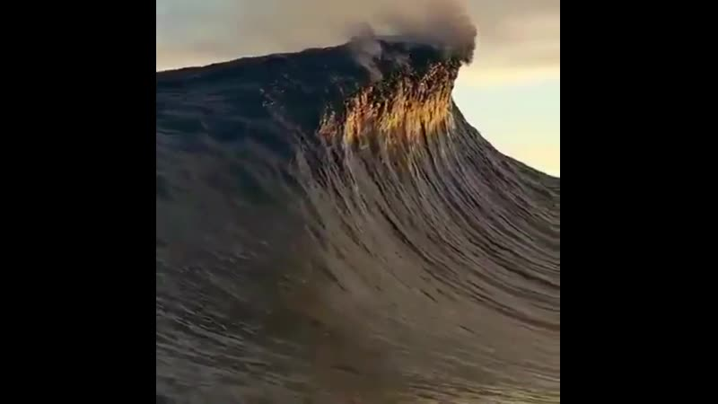 Wave so high that it touches the clouds