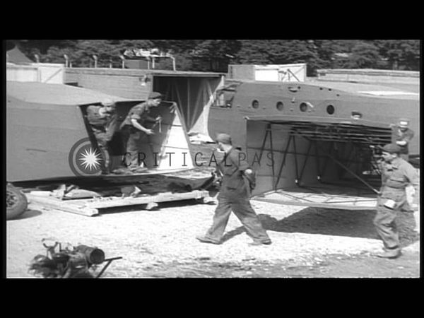 US Waco CG-4 assault gliders being assembled at RAF Station Greenham Common , Eng...HD Stock Footage