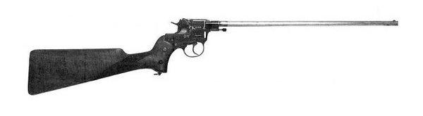НАГАН-КАРАБИН Редчайший представитель отечественного стрелкового вооружения - модификация знаменитого Нагана, а именно Наган-карабин.Идея о преобразовании пистолета в подобие винтовки были