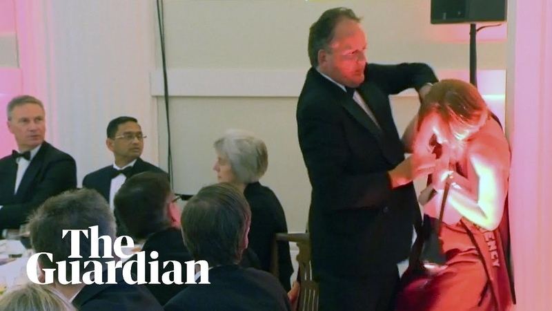 Conservative MP Mark Field grabs climate protester by the neck