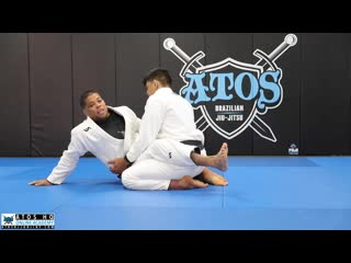 Andre Galvao - Basic and modified hip bump sweep from closed guard arm bar from mount position