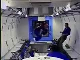 An astronaut in micro-g without access to handles or supports, is stuck floating