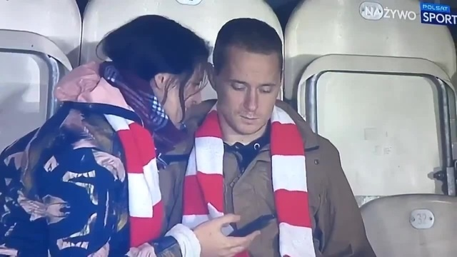 With a woman at the match