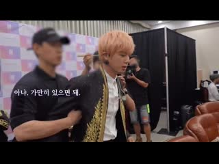 Staff asked Seokjin to be calm but Seokjin refused so he should held his arms im - -.mp4