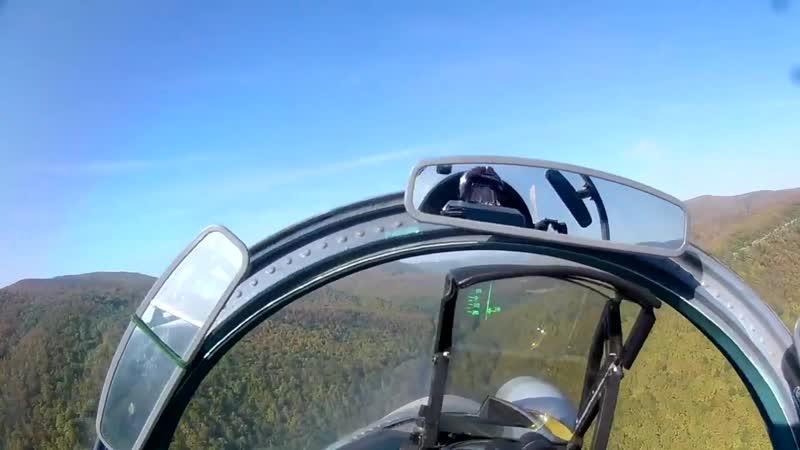 Учебные полеты модернизированных истребителей Су-27СМ3 и Су-30М2 ВКС России над горами Кавказа.