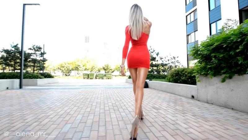 Walking Fitness model. Super Long Legs high Heels. Red Mini Dress.