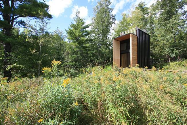 Modern off-grid cabin built by father