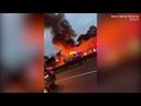 Crane bursts into flames on Sydney motorway during peak hour
