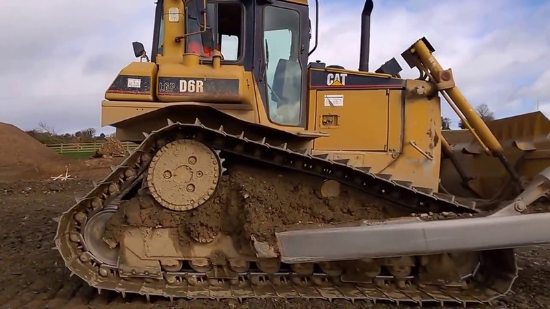 CAT D6 dozer at work levelling stone on a road construction site