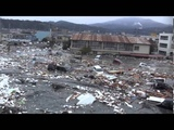 Tsunami in Kesennuma city, ascending the Okawa river