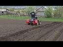 Делаю борозды под посадку картофеля на самодельном тракторе.