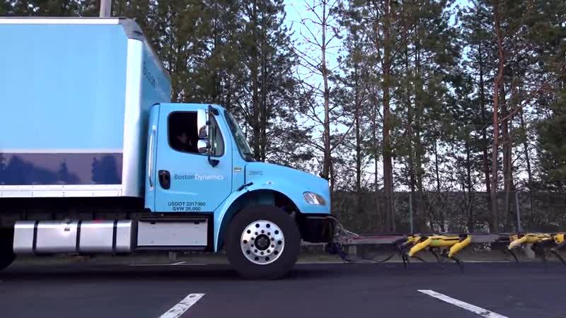 Роботы Spotpower от Boston Dynamics тянут грузовик.mp4
