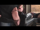 Hunk tickled by feather on his feet and upper body