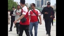 Arsenal fans wearing Henrikh Mkhitaryan shirts stopped by police in Baku