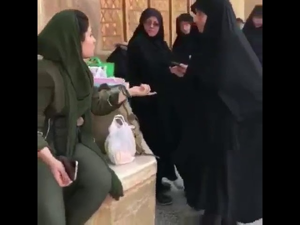 The moral police asks an Iranian woman to wear her hijab