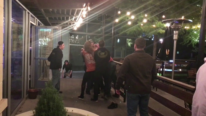 Texas Tech and UT Fans Snuggle with a Punch-Bar Fight