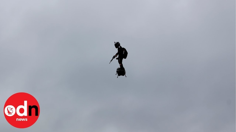 Man Rockets through the Air in Paris as France Celebrates Bastille Day with Parade
