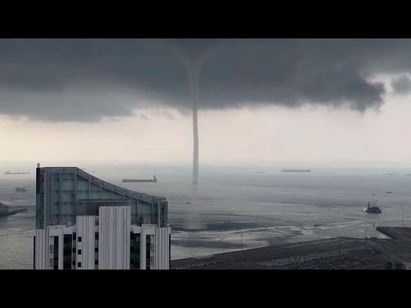 Waterspout swirls near Singapore shore