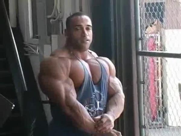 Bodybuilder Dennis James posing massive muscle