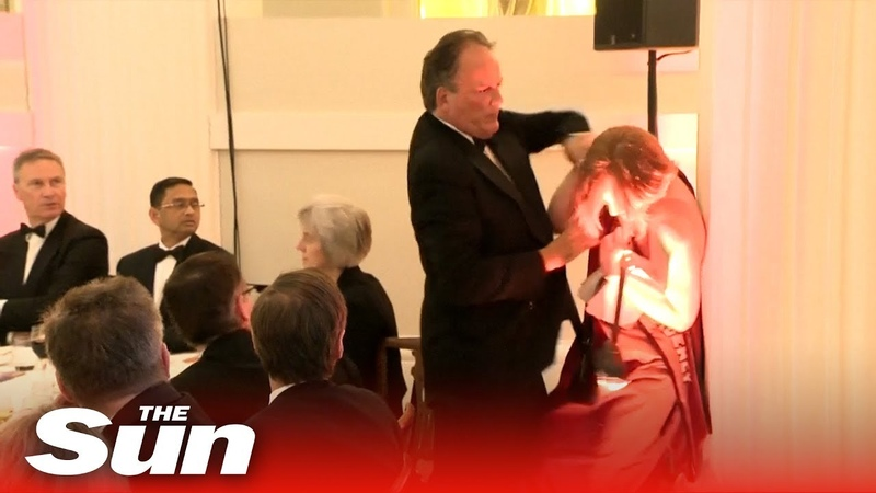 Tory MP grabs Greenpeace activist by her neck | Mark Field MP