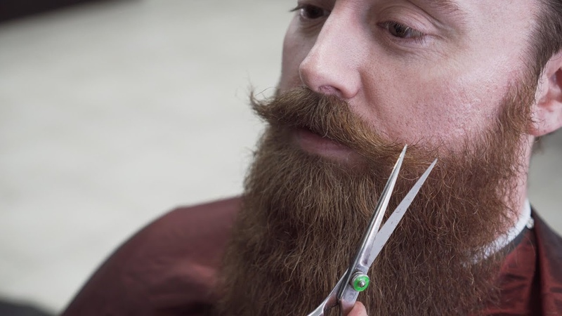 Beard Barber Trims and Shapes a Big Beard and Handlebar Mustache
