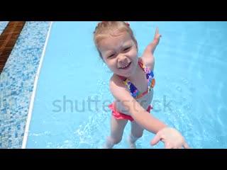stock-footage-little-kid-girl-have-fun-enjoy-swim-in-swimming-pool-blue-water-on