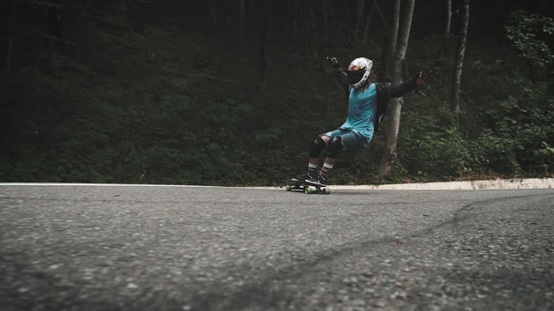 Downhill skateboarding Speed fall and stand up