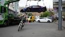 Misha's Day 52 Bicycle wheelie under the Lamborghini