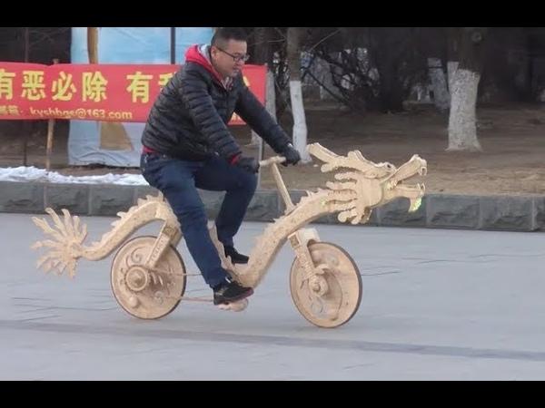 В Китае велосипед-дракон изрыгает пламя