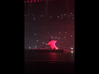Travis Scott falls off into a pit whilst on stage at a Drake concert at the O2 Arena London