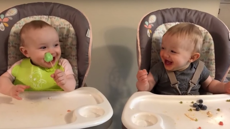 Twins share frozen treat and get the giggles