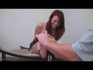 Tickling the feet of a cute 19 year old girl