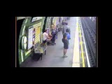 Baby and pram roll onto London Underground train tracks