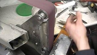 Sanding a Puukko knife blade freehand.