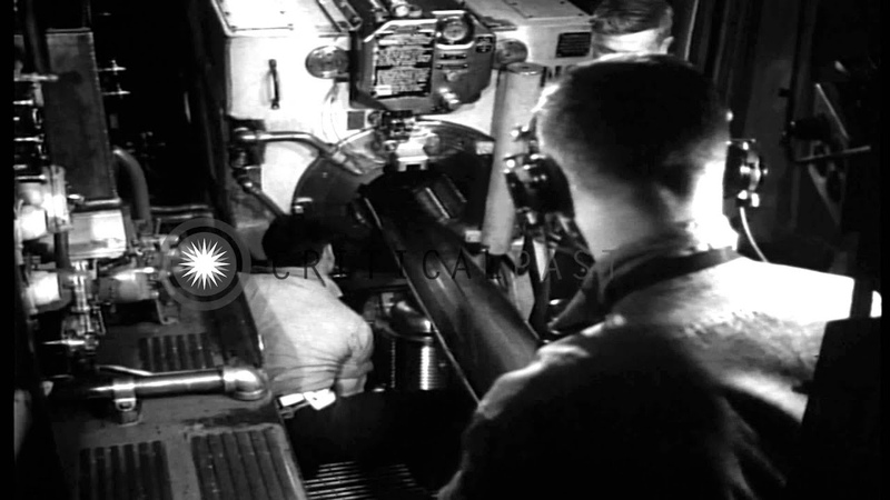 Naval guns aboard USS Quincy are fired at an enemy ship in the Pacific Ocean duri...HD Stock Footage