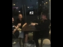 Rich Brian arm wrestling with Bro
