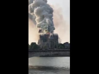 Breaking news huge fire reported at notre dame cathedral in paris, france. - -
