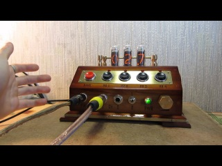 Jack and Alexx customs. Programmable tattoo power supply with nixie tubes IN-14