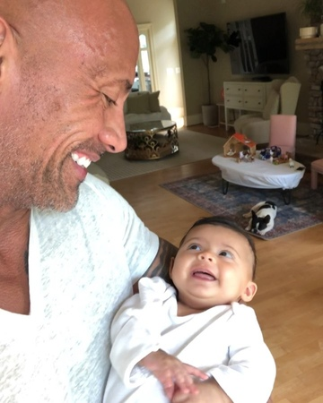 "@therock on Instagram: ""Me: I'm gonna just fish for compliments all day when I hold you in my arms. Baby Tiana Gia: I'm gonna look up at you with ..."